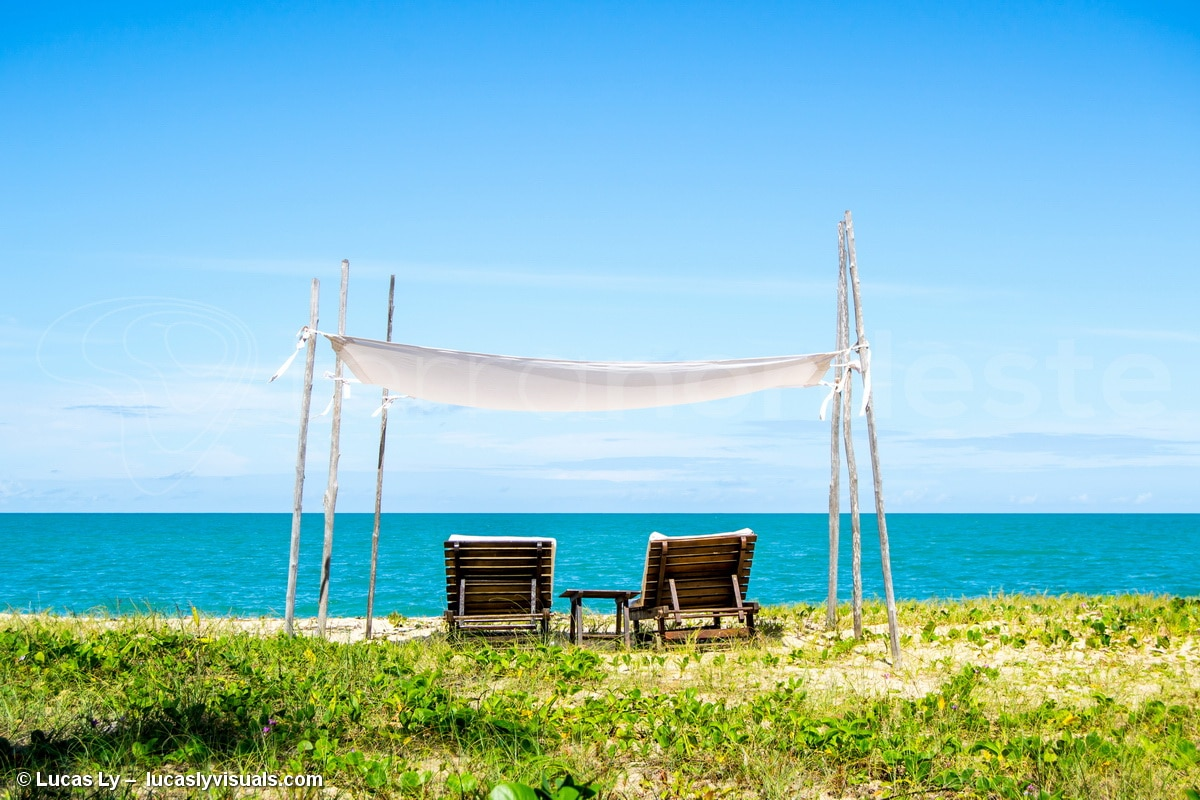Brazil, Bahia Trancoso - Caraiva, sun loungers on the deserted beach